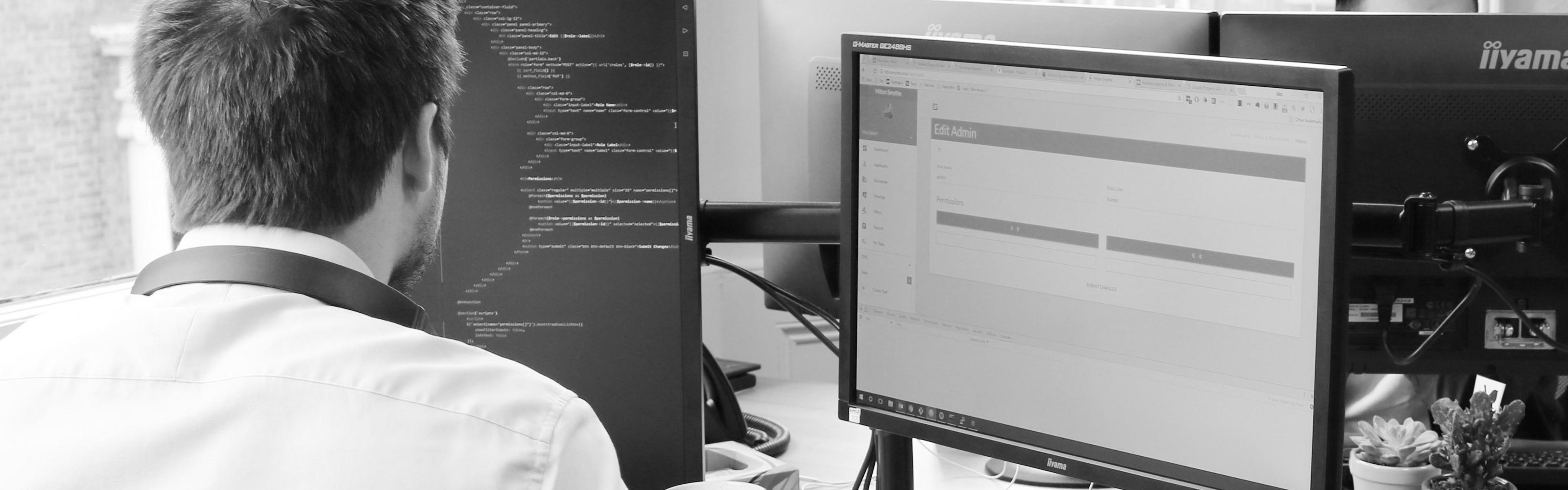 A Blue Wren bespoke software developer working on a bespoke software development project in Blue Wren's HQ in Winckley Square, Preston, Lancashire