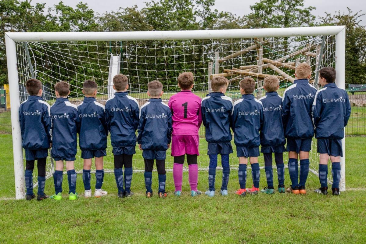 Walmer Bridge FC U10s wearing the Blue Wren sponsored kit